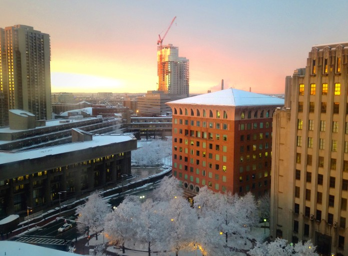the sun breaks out at twilight as the snow tapers off