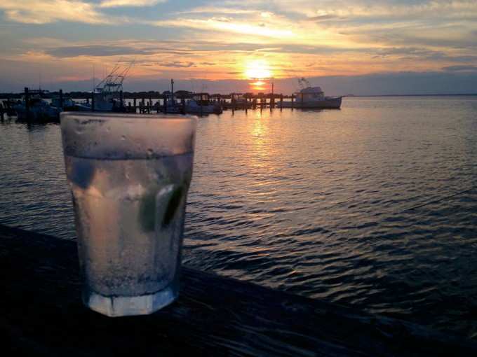 gin and tonic and sunset