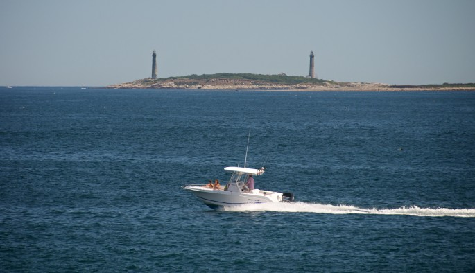 Thacher Island Twin Lighthouses (with outboard motorboat)